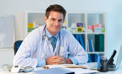 Photo of a medical Doctor sitting in his office